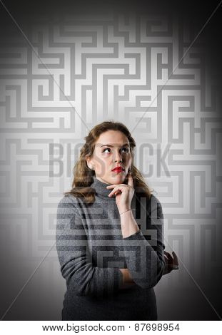 Maze. Girl In Grey Solving A Problem.