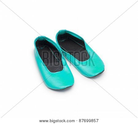 Childrens Gym Shoes Isolated Against A White Background
