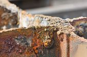 pic of girder  - Detail shot of cut rusty steel beams from an old bridge - JPG