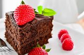 pic of chocolate fudge  - Fresh Home Made Sticky Chocolate Fudge Cake With Strawberries And Raspberries and a jug of pouring cream - JPG