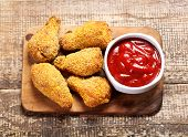 stock photo of southern fried chicken  - a fried chicken on a wooden board - JPG