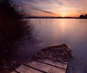 Постер, плакат: Long Exposure Lake At Sunset
