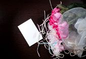 image of garter  - Beautiful pink roses pearl beads and garter lie on a table near the note - JPG