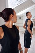 image of mirror  - young professional business woman checking elegant dress in mirror reflection at home bedroom - JPG
