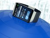 foto of over counter  - smartwatch with fitness app over an exercise ball blurred background  - JPG