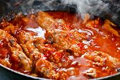 foto of stew  - Stewed chicken with spices in a tomato sauce - JPG