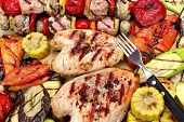 stock photo of  breasts  - Grilled Chicken Breast Mixed Vegetables and Fork On Wood Cutting Board Close - JPG