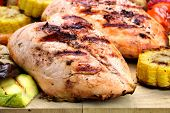 image of bast  - Grilled Chicken White Meat And Vegetables On Wood Cutting Board Close - JPG