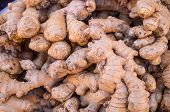 picture of stall  - A heap of fresh ginger roots on a street market stall - JPG