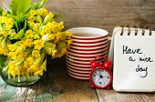 stock photo of strip  - Tea time red stripped cup of tea spring flowers and Have a nice day note - JPG