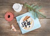 pic of porridge  - Rice porridge with milk cinamon banana and blueberry with Christmas  - JPG