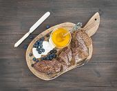picture of brie cheese  - Breakfast set on a dark wood background - JPG