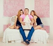 foto of threesome  - happy man with big cake and two women - JPG