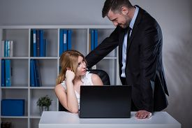 stock photo of seduce  - Handsome businessman seducing his beautiful younger assistant - JPG
