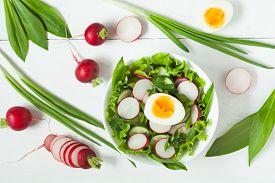 stock photo of radish  - Healthy clean eating vegetarian salad with radish - JPG