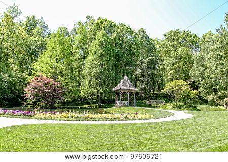 Gazebo And Bridge In Green Public Garden