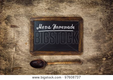 Wooden spoon and Black board