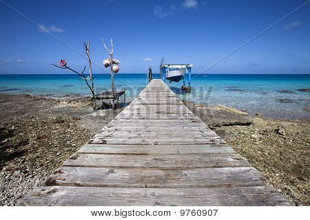 Fishermen's Boat On Blue Lagoon
