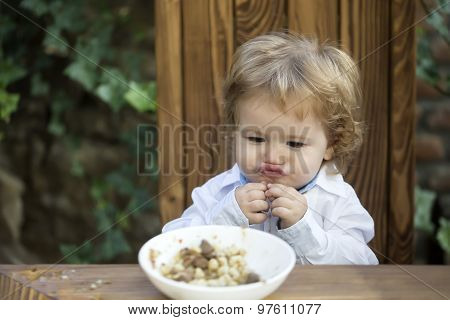 Funny Baby Boy Eating Outdoor