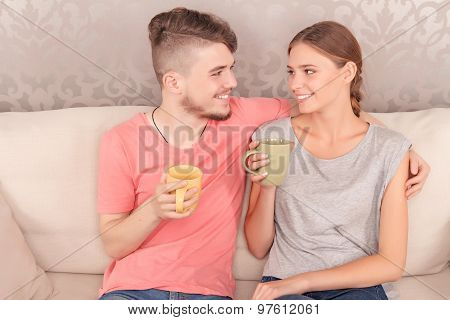 Lively young couple drinking tea