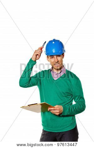 Architect Holding A Checklist. Builder Has A Pen On The Helmet Itself.