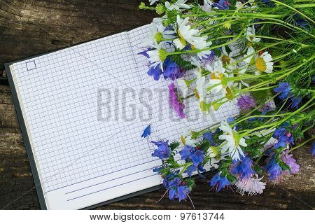 Colorful Wildflowers And Notebook For Recording