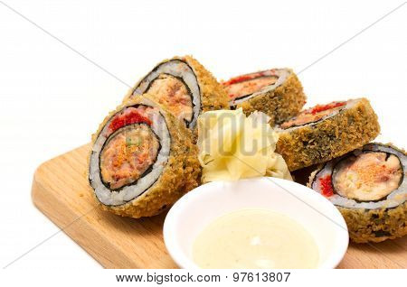 Dragon Eyes Roll On A Wooden Plate Against White Background