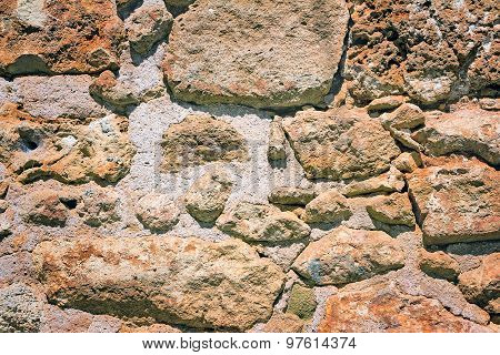 Fragment Of An Ancient Wall From Stones. (background Image)