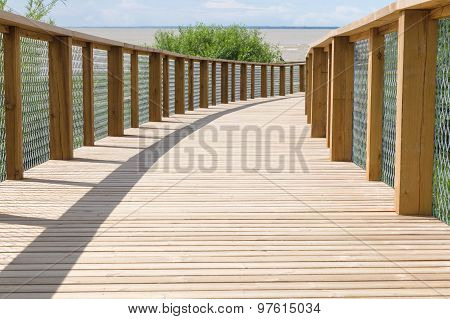 Wooden Plank Path With Safety Fence Leading To The Sea Shore