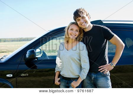 Couple Standing Near The Car
