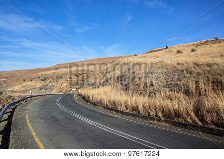 Gentle Curving Asphalt Road At Start Of Mountain Pass