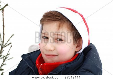 Portrait Of A Young Boy In A Santa Hat.