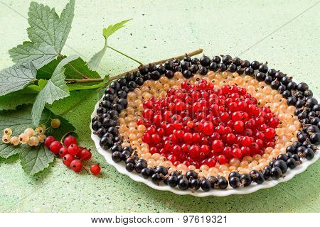 Red, White And Black Currants On A Plate