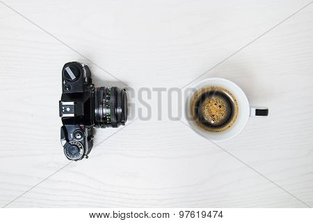 Cup of coffee and old camera