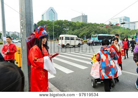 SHENZHEN, CHINA - JANUARY 06, 2015: night club promotion on the street. ShenZhen is regarded as one of the most successful Special Economic Zones.