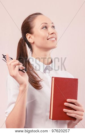 Nice young woman holding book