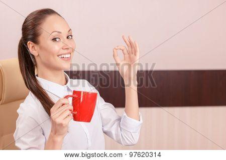 Pleasant girl drinking coffee