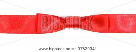 Real Red Bow Knot On Wide Silk Tape Isolated