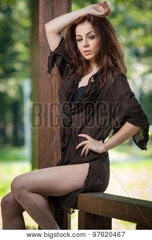 Beautiful female portrait with long brown hair outdoor. Genuine natural brunette with gorgeous eyes
