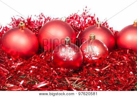 Many Red Christmas Balls And Tinsel Isolated