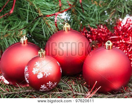 Few Red Christmas Baubles On Xmas Tree Background