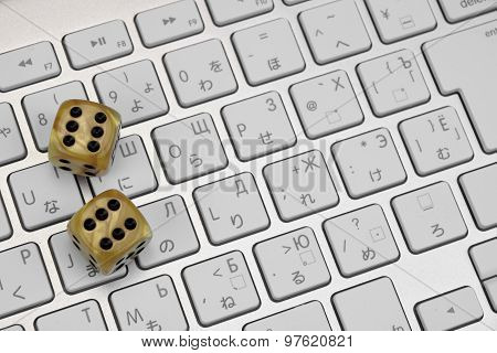 Gaming Dices  On The Computer Keyboard Close-up