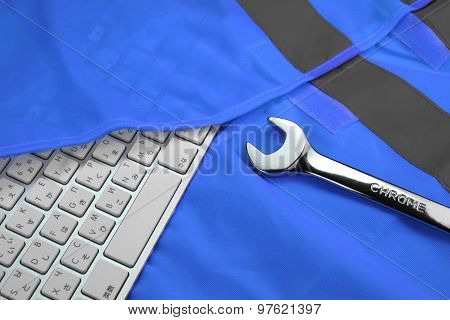 Keyboard In The Blue Reflective Safety Vest And Wrench