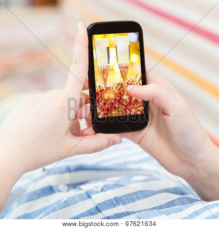 Woman Touches Smartphone With Gold Xmas Still Life