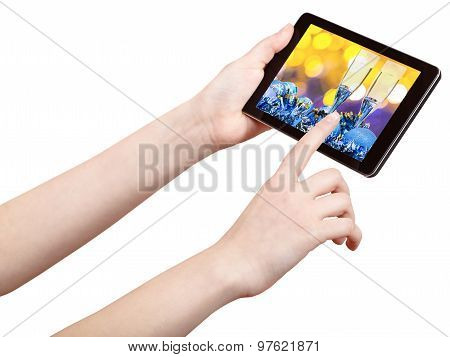Hand Touches Tablet Pc With Xmas Still Life
