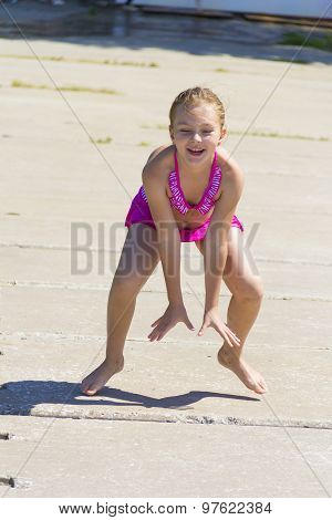 Jumping Girl In Pink Swimsuit