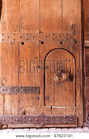 Old worn strong wooden door