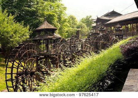 Waterwheel Front Of Entrance To  Huanglong Cave In China.
