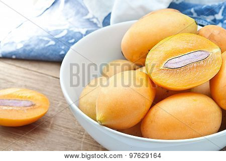 Sweet Marian Plum Fruit In Bowl On Wooden Background (mayongchid Maprang Marian Plum And Plum Mango,