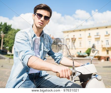 Young Man On Scooter